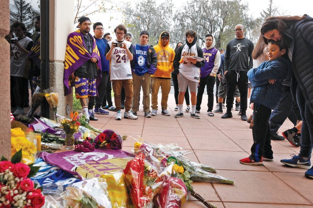 STUNNED SADNESS—Mourners pay their respects at the memorial for Kobe Bryant outside Mamba Sports Academy in Newbury Park on Jan. 27, 2020. Acorn file photo