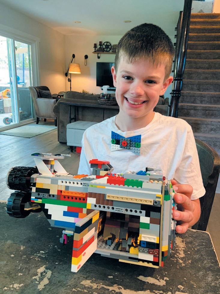 Created by Cameron French READY TO LAUNCH—The Rexcelsior spaceship from the Lego Movie 2. The side opens and holds a few mini spaceships that can fly out. The back has four big boosters just like in the movie.