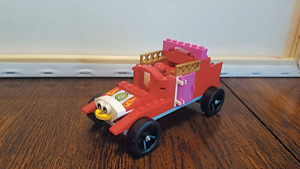 Created by Charlee Thames QUIRKY—The Chickies Mobile is a fast-paced car that uses a NAS tank and propeller in the back to give it maximum speed. The two pink French doors actually open.
