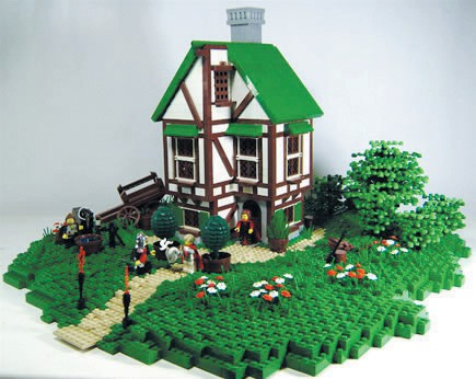 IDYLLIC—A nice little medieval-looking cottage with grass, trees and flowers. The cottage is white with brown decor on the outside and a green roof and window shade. Created by Dylan Jones EDITOR'S CHOICE