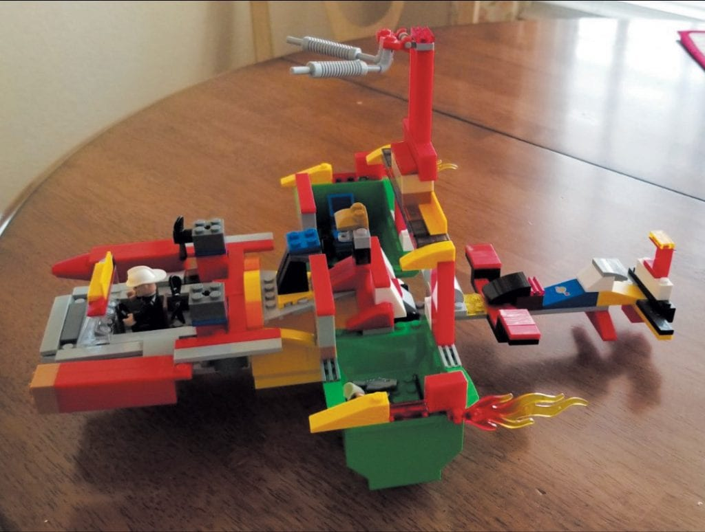 Created by Mason Malanga OUTTA SIGHT—A Lego battleship that fires missiles. Notice the wings and luggage compartments.