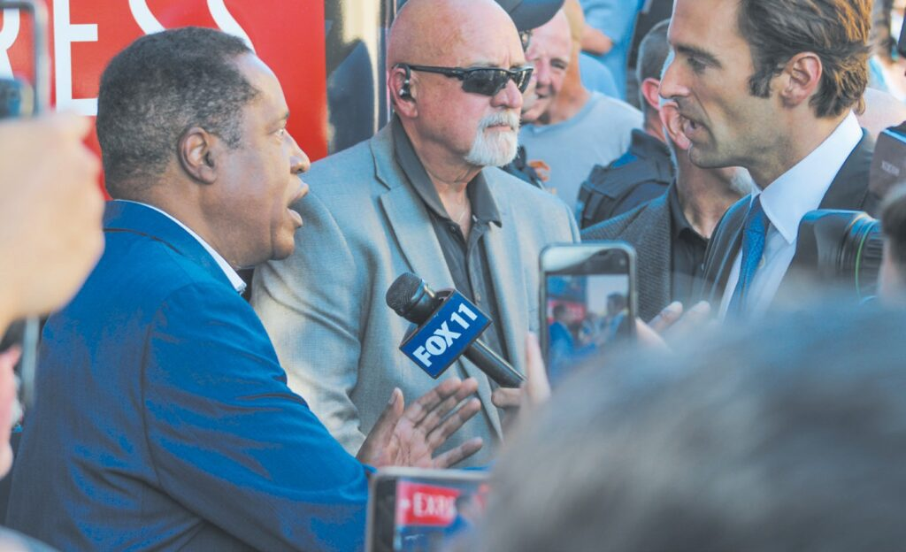 CAMPAIGNING— Larry Elder, left, speaks with Elex Michaelson of FOX 11 News outside the Junkyard Cafe in Simi Valley on Sept. 12. The candidate also made a brief speech inside the restaurant. Courtesy of MICHAEL SCOTT